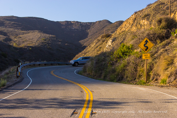 The first proper 'hairpin' up Decker Canyon Road from the PCH. Further up the hill, the road follows the line of utility poles that are visible higher on the right-hand side of the photo.